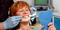Woman having an implant denture put in