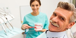 Smiling man with dentures at the dentist