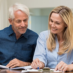 Man and woman reviewing dental insurance policies