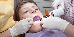 A child receiving dental treatment.
