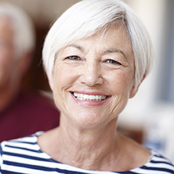Elderly lady with striped shirt smiling